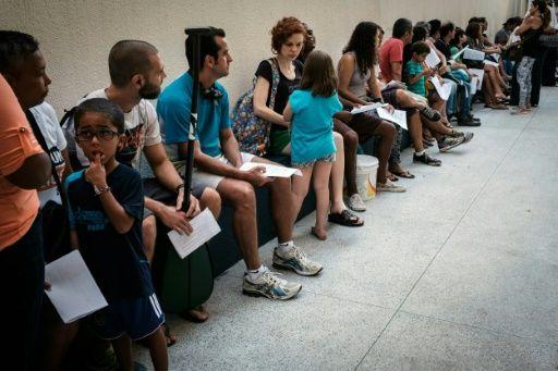 filas para realizar un certificado médico